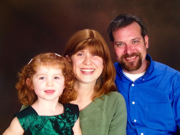 Clay Parker, his wife Laura, and their daughter.