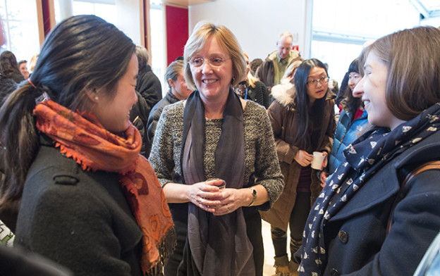 Smith College President Kathleen McCartney talks with female students.