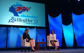 Lean In author Sheryl Sandberg and BlogHer cofounder Lisa Stone on stage at Blogher 2013