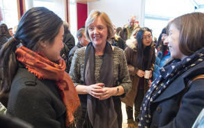 Smith College President Kathleen McCartney talks with female students.